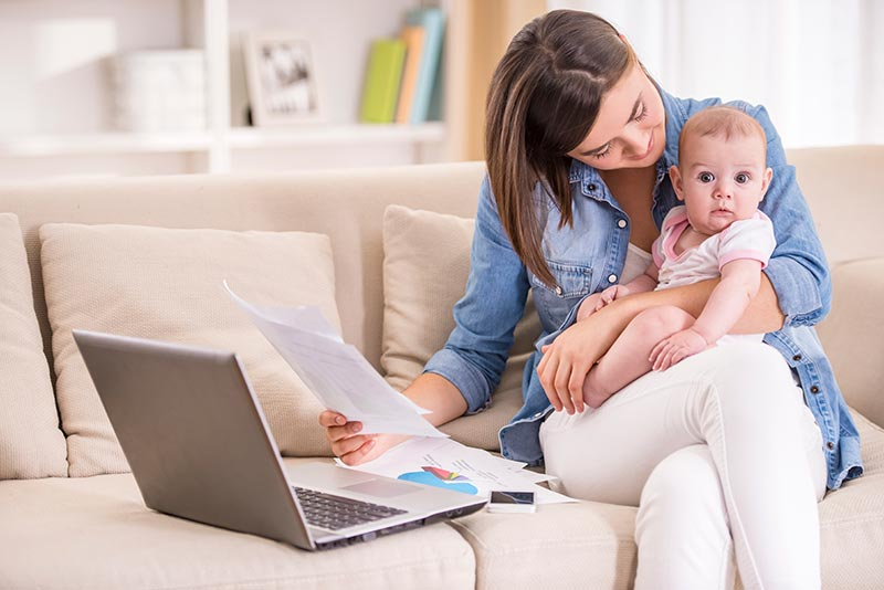 Mother working from home with baby on her lap